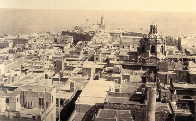 Valletta rooftops Malta with St. Elmo's Lighthouse 1870